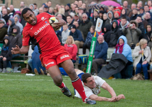 Saracens Kameli Ratuvou scores a try as Jed-Forests Gregor Young dives in for the tackle during the