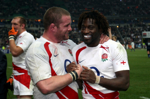 Englands Phil Vickery (l) and Paul Sackey celebrate at the end of the game