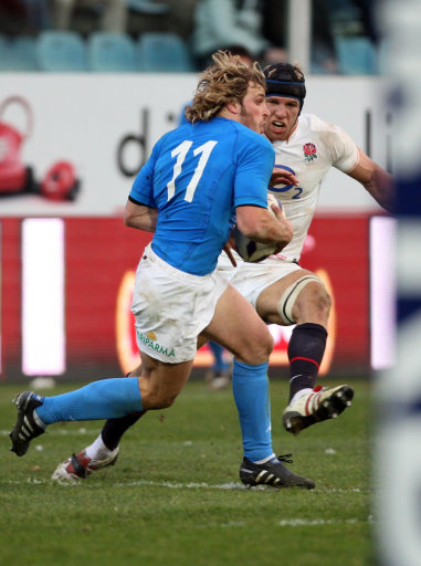 Englands James Haskell (right) challenges Italys Mirco Bergamasco during the RBS 6 Nations match at