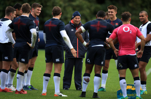 England coach Eddie Jones speaks with his team during a training session at Pennyhill Park, Bagshot.
