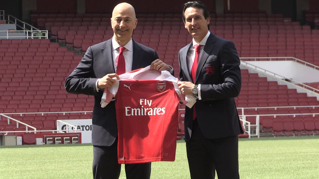 Unai Emery (right) with chief executive Ivan Gazidis on the pitch after a press