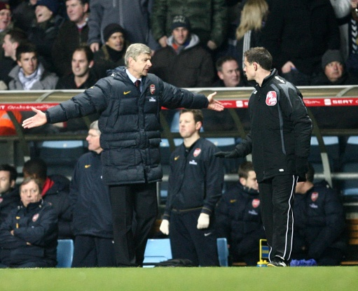 Arsenal manager Arsene Wenger shows his frustration to the fourth official