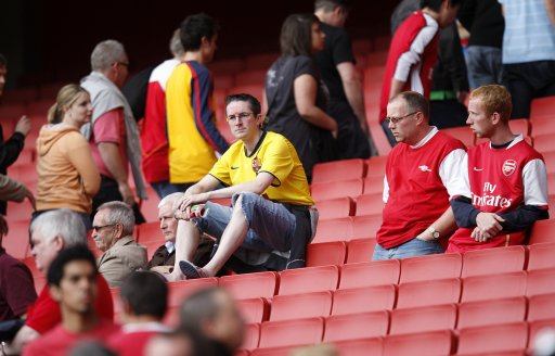 fans sit dejected in the stands after the final whistle