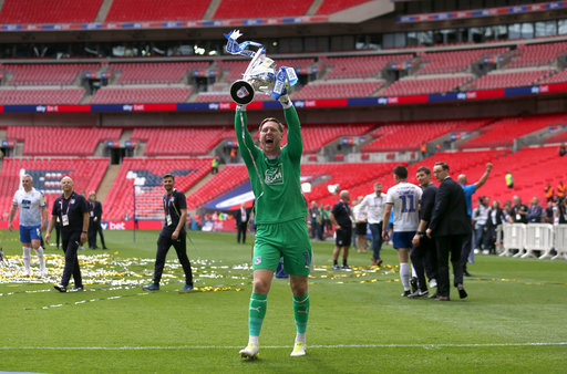 Tranmere Rovers goalkeeper Scott Davies celebrates with the trophy after his side win the Sky Bet Le