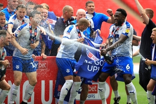 Tranmere Rovers celebrate after the final whistle during the Sky Bet League Two Play-off final at We