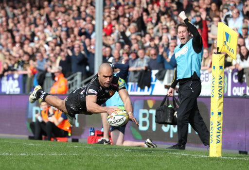Exeter Chiefs' Olly Woodburn dives over to score a try during the Aviva Premiership match at Sandy P