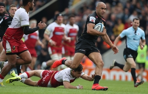 Exeter Chiefs' Olly Woodburn breaks past Northampton Saints' Tom Collins during the Gallagher Premie