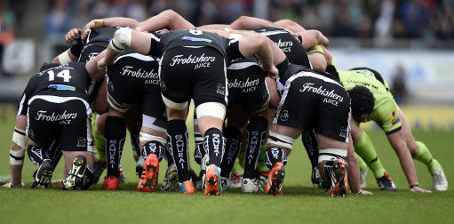 General view of the back of a scrum by Exeter Chiefs players wearing Samurai branded socks