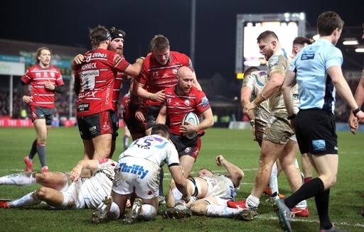Willi Heinz (centre) celebrates scoring his side's second try with team-mates during th