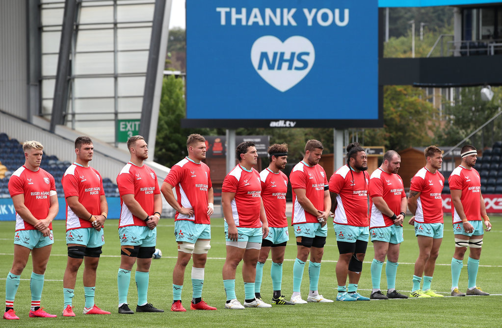 Gloucester players with a thank you to the NHS prior to kick-off during the Gallagher Premiership ma