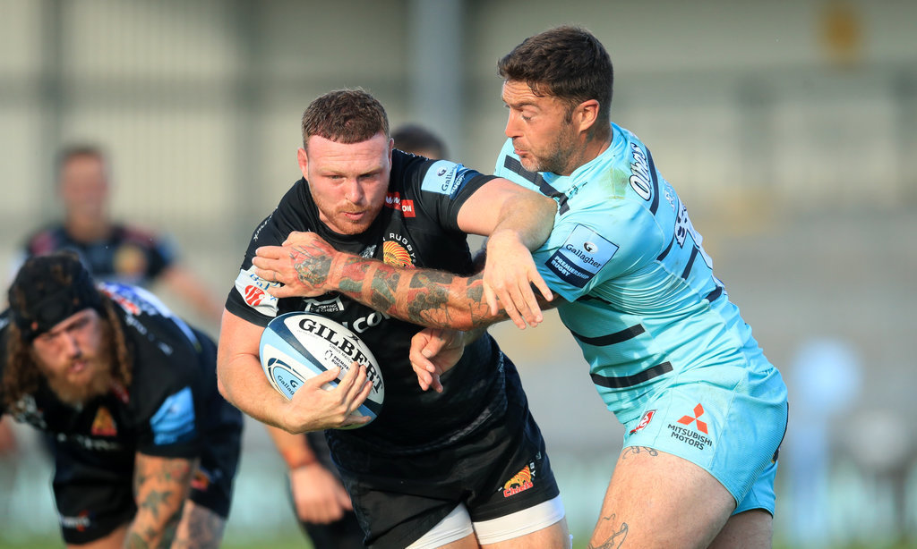 Exeter Chiefs' Sam Simmonds (left) is tackled Gloucester's Matt Banahan during the Gallagher Premier