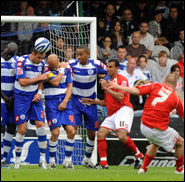 Iain Hume (number 7) of Barnsley tries to bend a free-kick over the Queens Park Rangers wall during