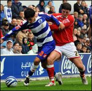 Emmanuel Ledesma (left) of Queens Park Rangers, in action against John Macken of Barnsley during the