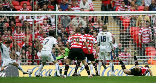 Doncaster Rovers James Hayter (far right) heads home the opening goal of the game.