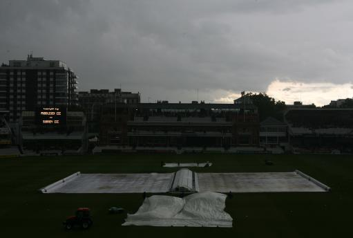 Dark clouds over Lords as play is delayed between Middlesex Crusaders and Surrey Brown Caps
